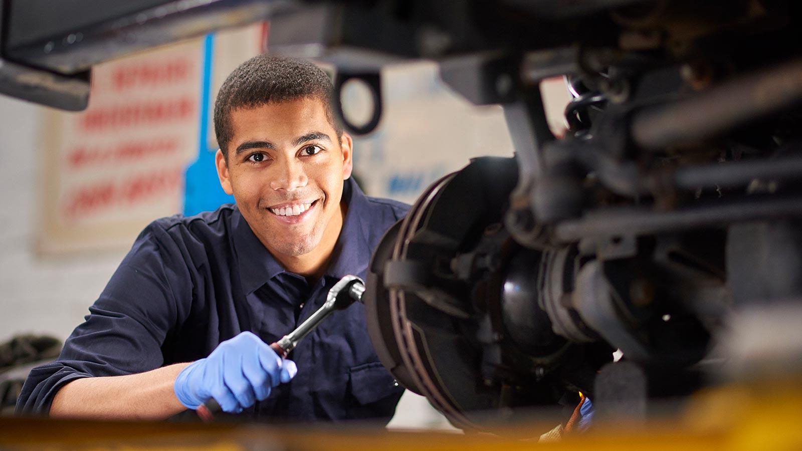 Tunex Services mechanic working on car